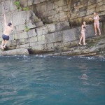 Jumping into the river from different heights.