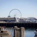 From left to right: The Seattle Great Wheel, CenturyLink Field, Safeco Field, and Mount Rainier.